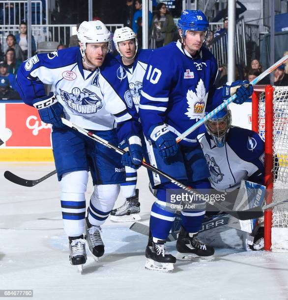 Cal O'u2019Reilly of the Toronto Marlies fights for crease space with goalie Mike McKenna Slater Koekkoek and Ben Thomas of the Syracuse Crunch...