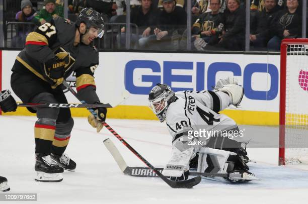 Cal Petersen of the Los Angeles Kings saves a shot by Max Pacioretty of the Vegas Golden Knights during the second period at TMobile Arena on March...