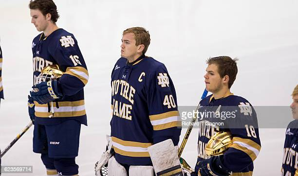 Cal Petersen of the Notre Dame Fighting Irish listens to the national anthem prior to a game against the Northeastern Huskies during NCAA hockey at...