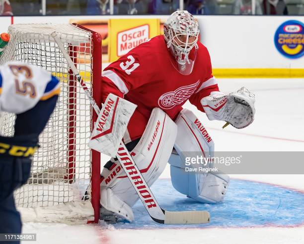 Cal Pickard of the Detroit Red Wings follows the play against the St Louis Blues in the third period during a preseason Kraft Hockeyville game at the...