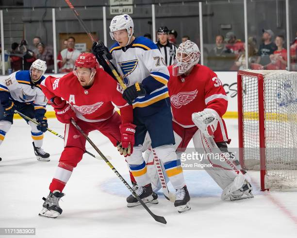 Cal Pickard of the Detroit Red Wings follows the play as teammate Danny DeKeyser battles in front with Oskar Sundqvist of the St Louis Blues in the...