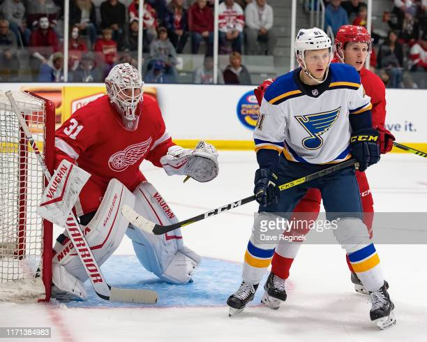Cal Pickard of the Detroit Red Wings follows the play as teammate Dennis Cholowski battles in front of the net with Ryan Olsen of the St Louis Blues...