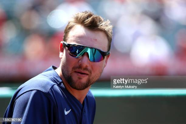 Cal Raleigh of the Seattle Mariners looks on from the dugout during the fifth inning against the Los Angeles Angels at Angel Stadium of Anaheim on...