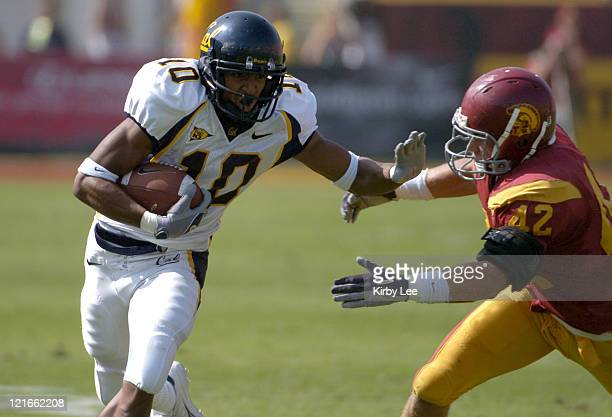 Cal receiver Burl Toler is pursued by USC linebacker Dallas Sartz during 2317 loss in Pac10 Conference football game at the Los Angeles Memorial...