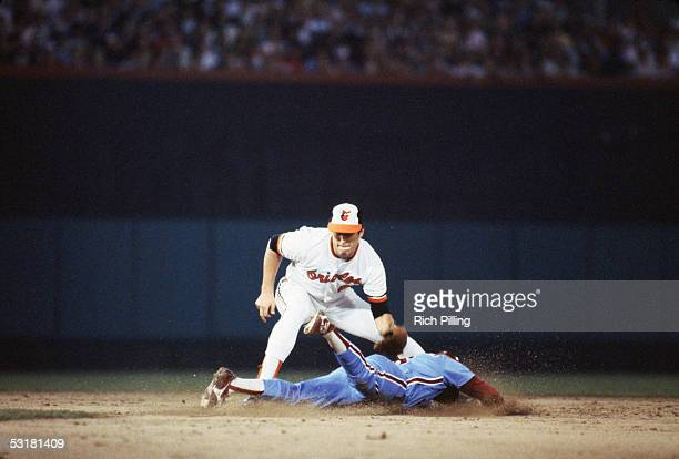 Cal Ripken Jr #8 of the Baltimore Orioles attempts to tag out a runner at second base during a 1983 World Series game against the Philadelphia...