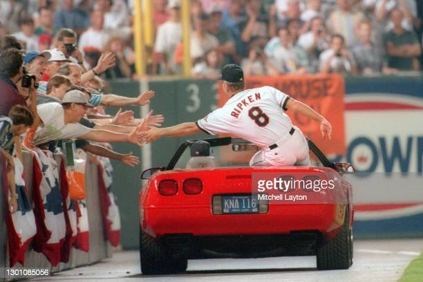 Cal Ripken Jr. #8 of the Baltimore Orioles celebrates breaking Lou Gehrig's record for consecutive game played with his 2131 career game, during a...