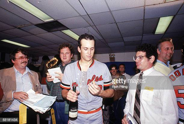 Cal Ripken Jr #8 of the Baltimore Orioles celebrates in the locker room after the Orioles win the 1983 World Series defeating the Philadelphia...
