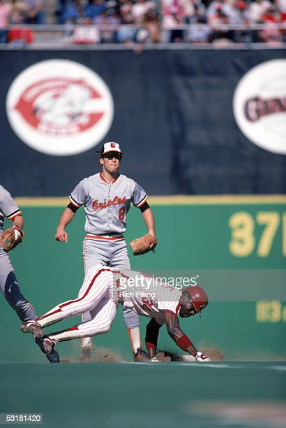 Cal Ripken Jr #8 of the Baltimore Orioles goes to cover second base as Gary Matthews Sr #34 of the Philadelphia Phillies dives back to base during a...