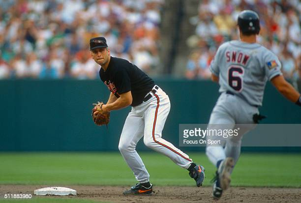 Cal Ripken Jr #8 of the Baltimore Orioles looks to throw over the top of JT Snow of the California Angels during a Major League baseball game circa...