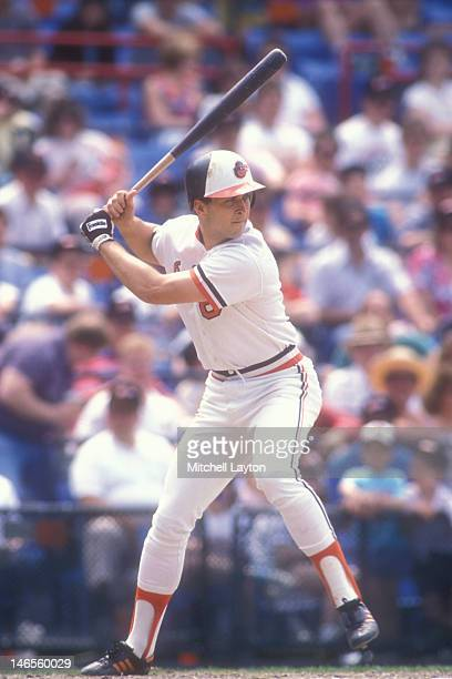 Cal Ripken Jr #8 of the Baltimore Orioles takes a swing during a baseball game against the Seattle Mariners on June 4 1989 at Memorial Stadium in...