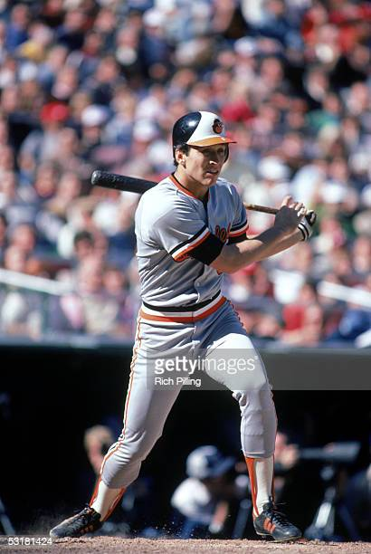 Cal Ripken Jr #8 of the Baltimore Orioles watches the flight of the ball as he follows through on his swing during a 1983 World Series game against...