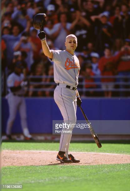 Cal Ripken Jr. Of the Baltimore Orioles acknowledges the crowd as he steps to the plate for his final at bat in Chicago versus the Chicago White Sox...