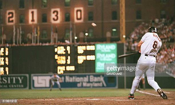 Cal Ripken Jr of the Baltimore Orioles hits a home run in the sixth inning of Baltimore's 05 September game against the California Angels at...