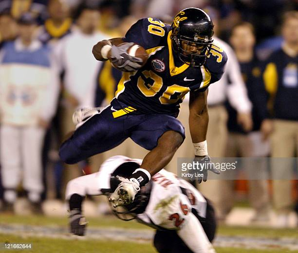 Cal running back JJ Arrington hurdles a Texas Tech defender during 4531 loss in the Pacific Life Holiday Bowl at Qualcomm Stadium in San Diego Calif...