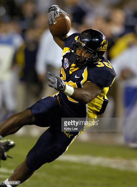Cal senior running back JJ Arrington heads up field during 4531 loss to Texas Tech in the Pacific Life Holiday Bowl at Qualcomm Stadium in San Diego...