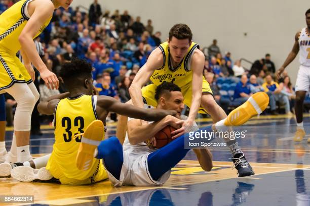 Cal State Bakersfield Roadrunners center Moataz Aly and Northern Arizona Lumberjacks forward Isaiah Thomas fight for a loose ball during the game...