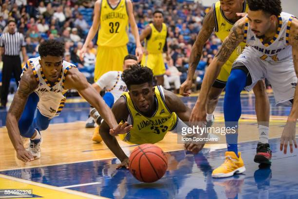 Cal State Bakersfield Roadrunners forward Greg Lee and Northern Arizona Lumberjacks forward Isaiah Thomas dive for a loose ball during the game...