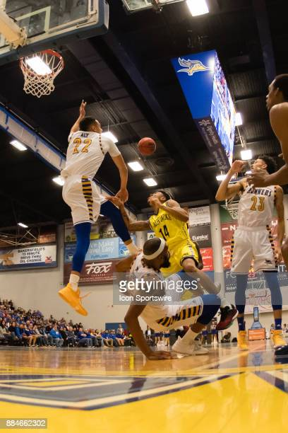 Cal State Bakersfield Roadrunners forward Shon Briggs collides with Northern Arizona Lumberjacks guard Karl Harris as he goes to the basket during...