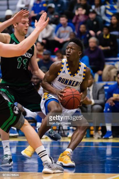 Cal State Bakersfield Roadrunners guard Jarkel Joiner changes direction as he drives the ball to the basket during the game between the Utah Valley...