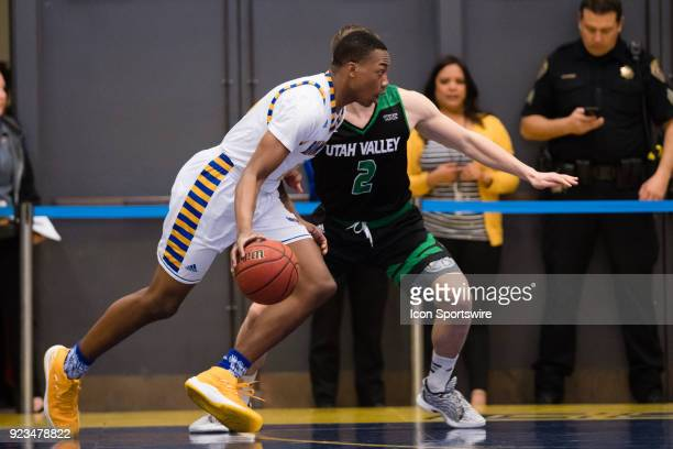Cal State Bakersfield Roadrunners guard Justin Davis drives the ball to the basket against Utah Valley Wolverines guard Jake Toolson during the game...