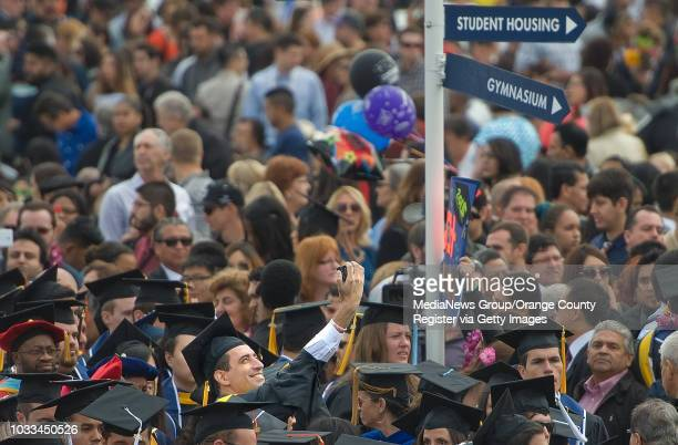 Cal State Fullerton graduate takes a selfie while enveloped in a sea of people after commencement ceremonies Saturday. Richard Lui, an MSNBC dayside...