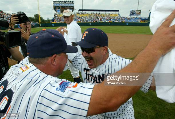 Cal State Fullerton Head Coach George Horton and assistant coach Rick Vanderhook celebrate their victory over Texas during the Division I Men's...
