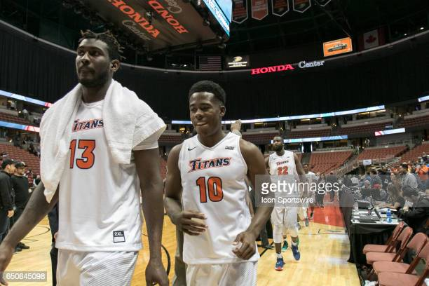 Cal State Fullerton players Arkim Robertson Austen Awosika and Richard Peters exit the court during a Big West Conference Quarterfinals game between...