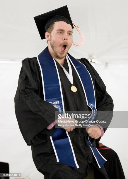 Cal State Fullerton student Arthur Wilson can't contain his excitement as he goes on stage to collect his diploma during the College of Arts ceremony...