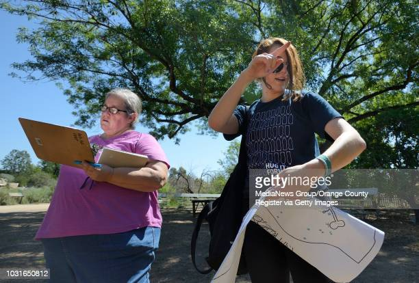 Cal State Fullerton student Katie Rummel right and grad student Donna Rader map the location of sprinkler valves at the Fullerton Arboretum on Friday...