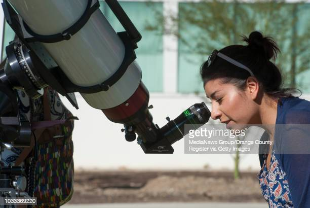 Cal State Fullerton student peers through a telescope set up outside Dan Black Hall to view the partial solar eclipse cssolar1105 Ð 10/23/14 Ð...