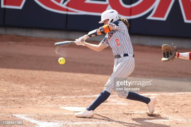 Cal State Fullerton Titans catcher Julia Valenzuela hits the ball during a college softball game between the Alabama Crimson Tide and the Cal State...