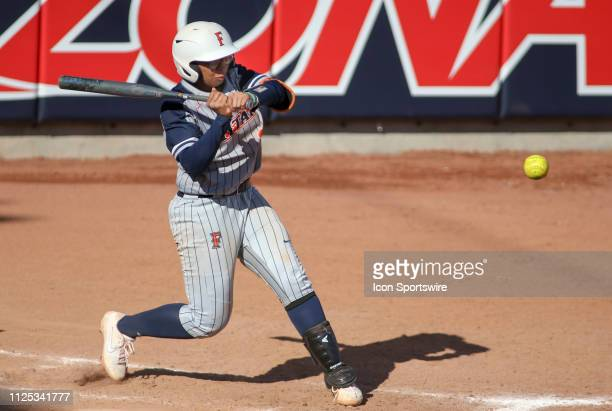 Cal State Fullerton Titans Deshea Hill tires to hit the ball during a college softball game between the Alabama Crimson Tide and the Cal State...