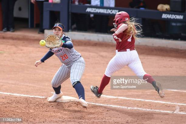 Cal State Fullerton Titans infielder Daisy Munoz catches the ball during a college softball game between the Alabama Crimson Tide and the Cal State...