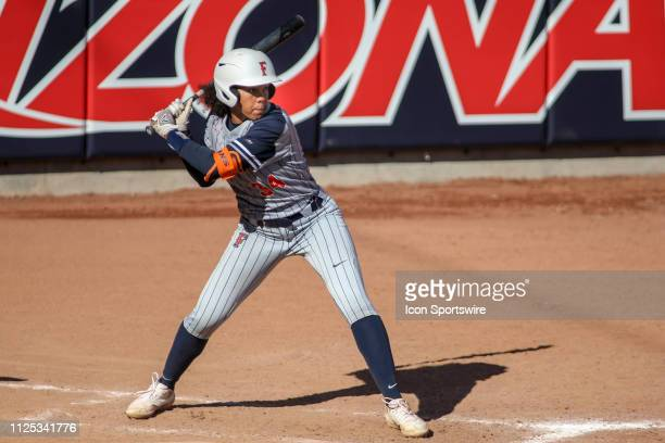 Cal State Fullerton Titans outfielder Ari Williams bats during a college softball game between the Alabama Crimson Tide and the Cal State Fullerton...