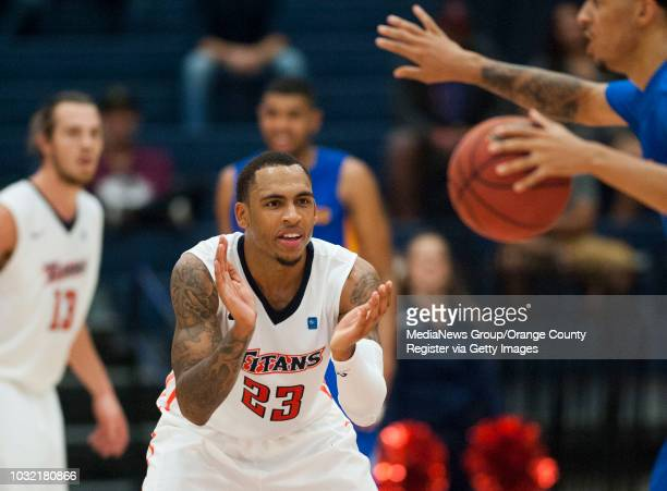 Cal State Fullerton's Alex Harris claps as San Jose State's Jalen James brings the ball downcourt during the Titans' 7066 victory over the Spartans...