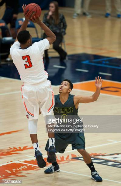 Cal State Fullerton's Moses Morgan shoots over UC Irvine's Jaron Martin during the Anteaters' 6358 victory over Cal State Fullerton at Titan Gym...