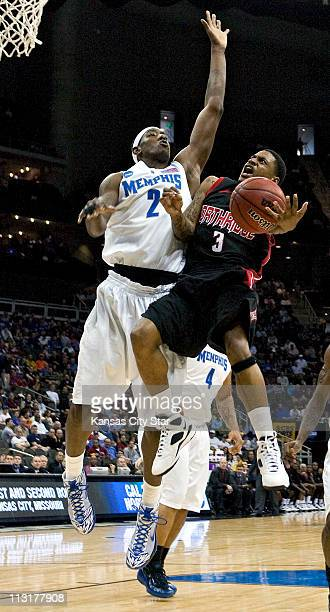 Cal State Northridge guard Mark Hill finds his way to the basket defended by Memphis forward Robert Dozier during NCAA first round basketball game at...