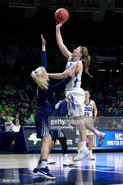 Cal State Northridge Matadors center Lauren Shymkewicz shoots over Villanova Wildcats guard Alex Louin during the first round of the Division I...
