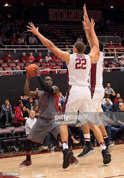 Cal State Northridge Matadors forward Rakim Lubin looks for an opening defended by Stanford Cardinal forward Reid Travis during the Cal State...