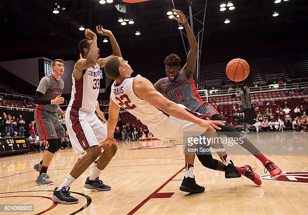 Cal State Northridge Matadors forward Tavrion Dawson and Stanford Cardinal forward Reid Travis tied up during the Cal State Northridge vs Stanford at...