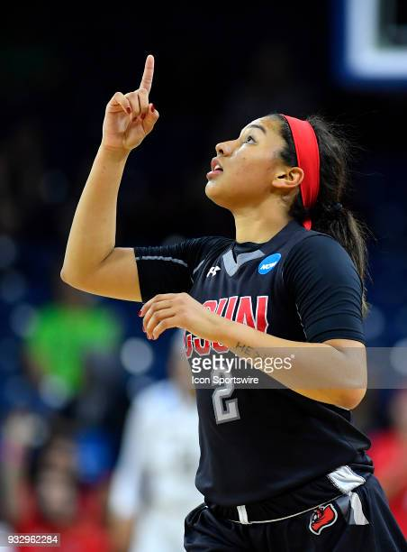 Cal State Northridge Matadors guard Destiny Brooks points upward after scoring against the Notre Dame Fighting Irish during the first round of the...