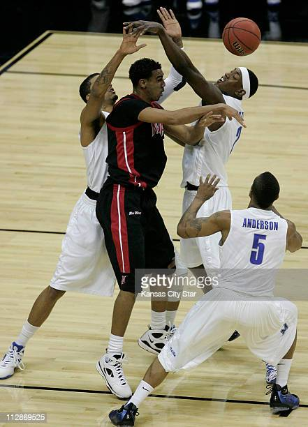 Cal State Northridge's Tremaine Townsend center is surrounded by Memphis players Shawn Taggart left Robert Dozier and Antonio Anderson in the first...