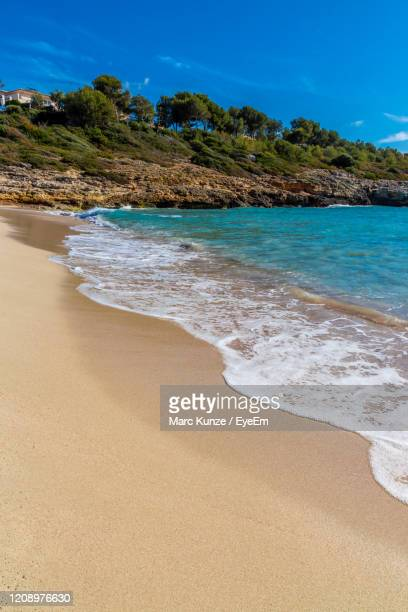 cala anguila beach with blue sky summer - manacor stock pictures, royalty-free photos & images