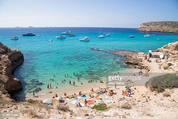 cala compte beach crystal water in ibiza summer - insel ibiza stock-fotos und bilder