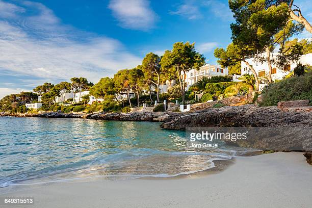 cala d'or at sunrise - insel ibiza stock-fotos und bilder