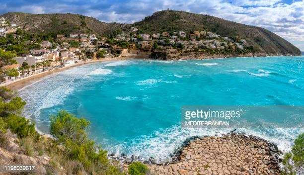 cala el portet beach in moraira alicante mediterranean - alicante stock pictures, royalty-free photos & images