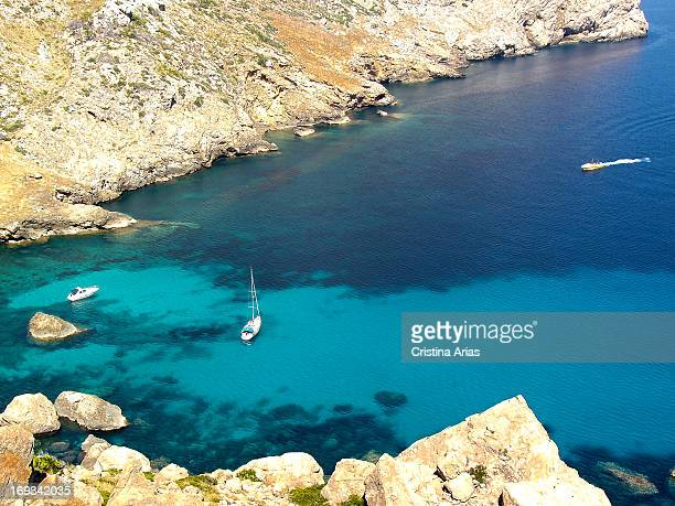 Cala Figuera in Formentor is a small cove of crystal clear waters and rocks surrounded by the rugged mountains of the Sierra de Tramuntana that go...