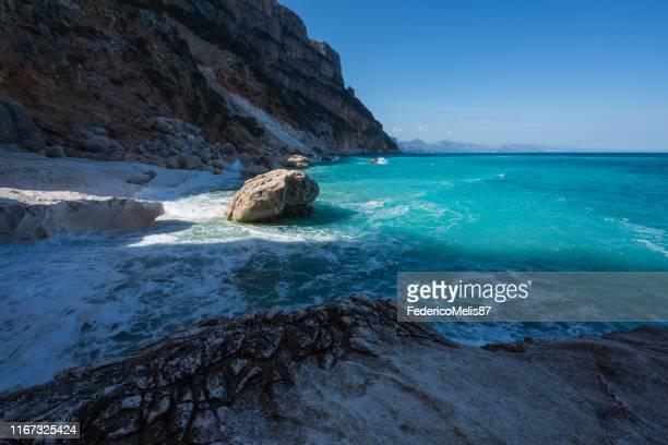 cala goloritze beach in winter, sardinia, italy - cala goloritze foto e immagini stock