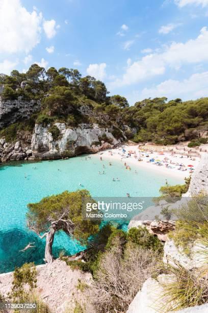 cala macarelleta beach at daytime, menorca, spain - カラマカレラ ストックフォトと画像
