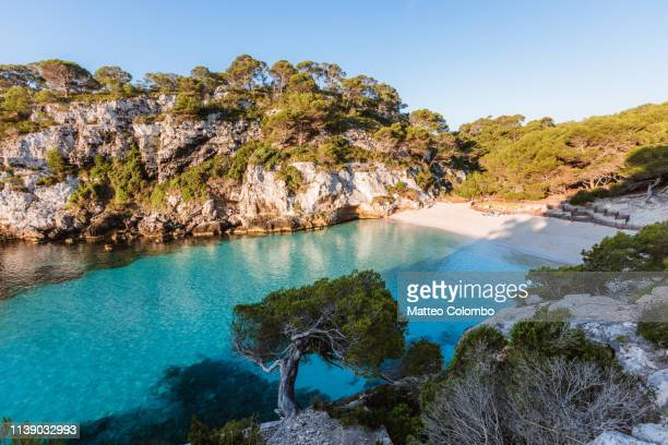 cala macarelleta beach at sunrise, menorca, spain - balearic islands stock pictures, royalty-free photos & images